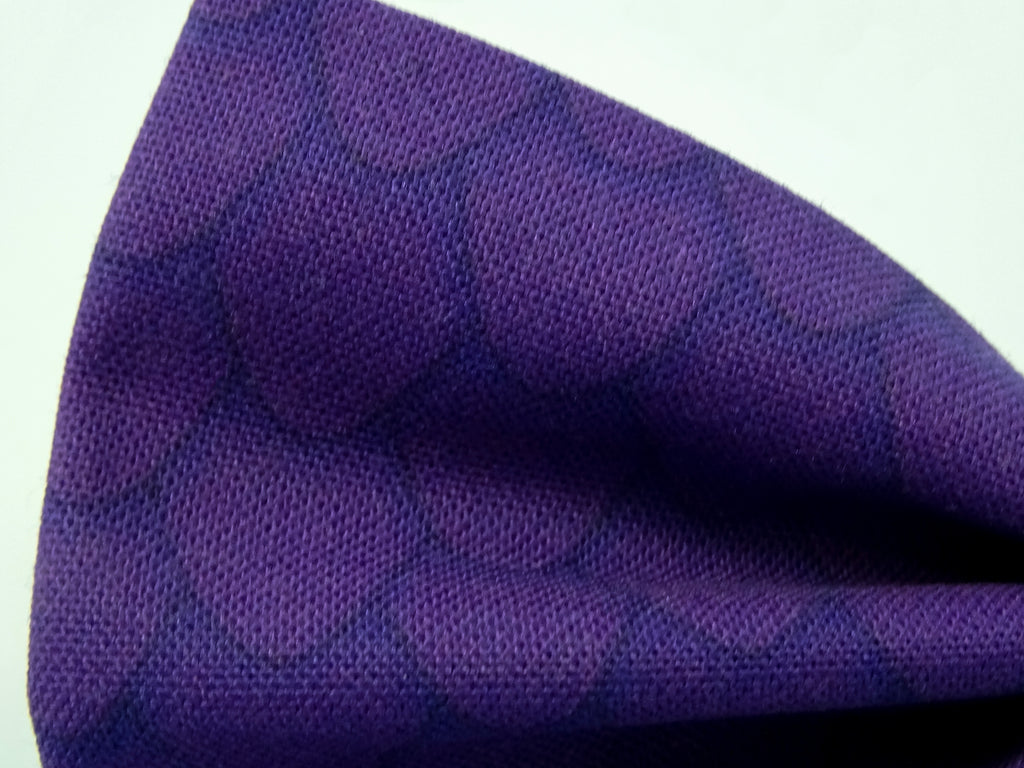 Detail on a Purple Dragon Scales Pre-Tied Bow Tie. This is a purple bow tie covered in my dragon scales pattern.