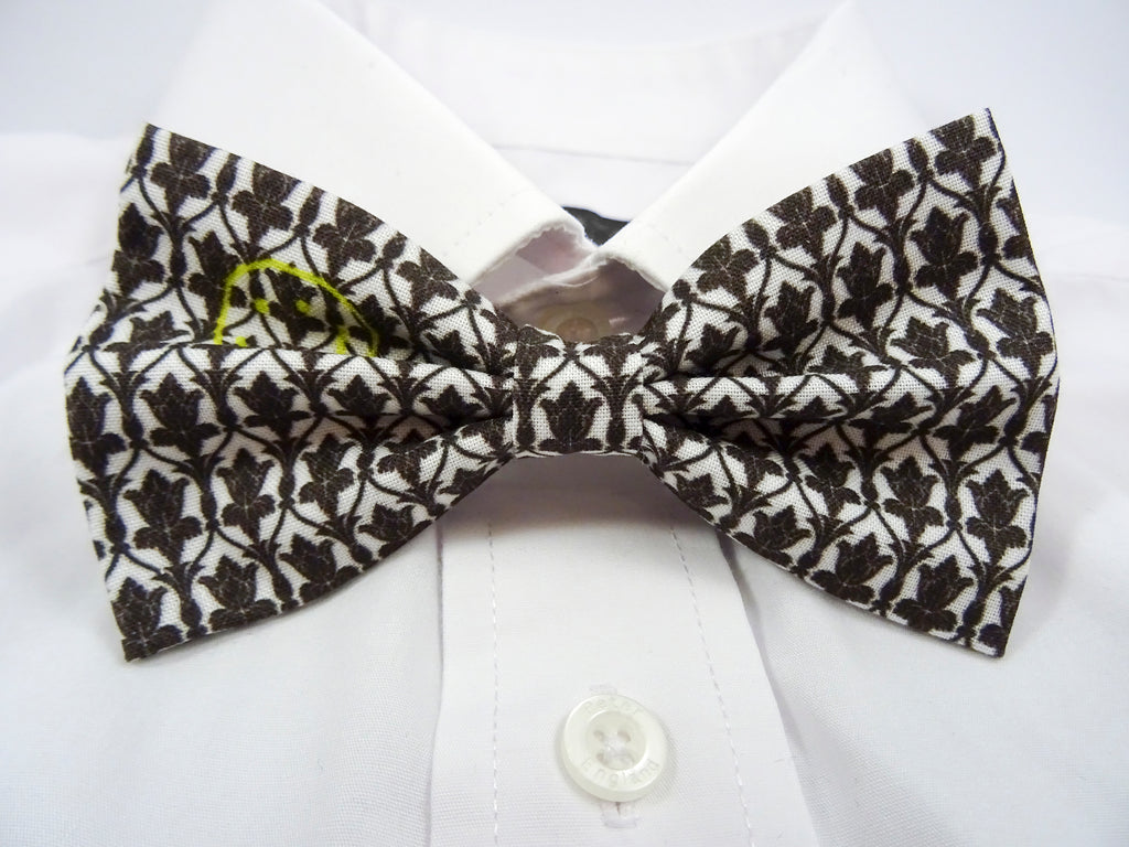 Sherlock Wallpaper Inspired Pre-Tied Bow Tie. This is a white & black patterned bowtie with a yellow smiley face.