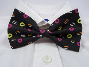 Liquorice Allsorts Pre-Tied Bow Tie. This is a black bow tie, covered in my liquorice allsorts pattern.