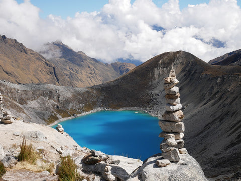 An unnamed vibrant blue glacial lake near Salkantay Mountain by Root Republic