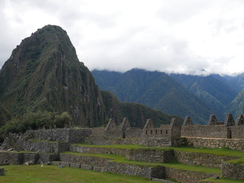 Clouds rolling in on Machu Picchu by Root Republic