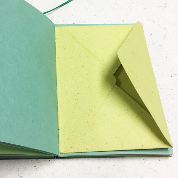 envelope stitched into pages of custom journal