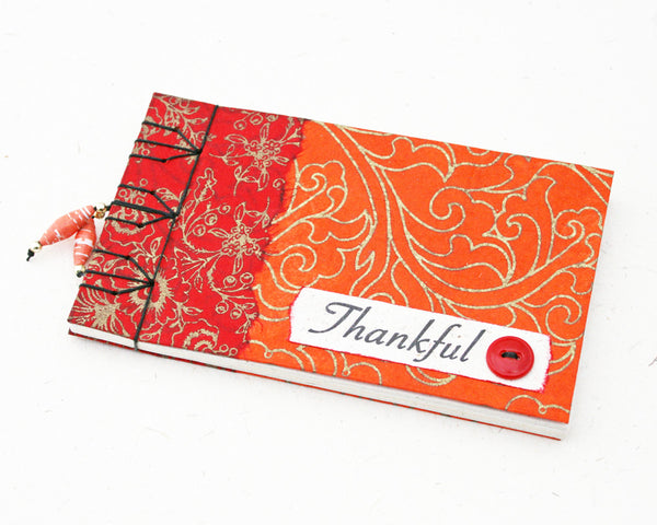 red gratitude journal
