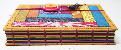 one of a kind coptic bound journal in jewel colours by Little Deer Studio