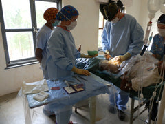 Ausnep team performing surgery in Nepal