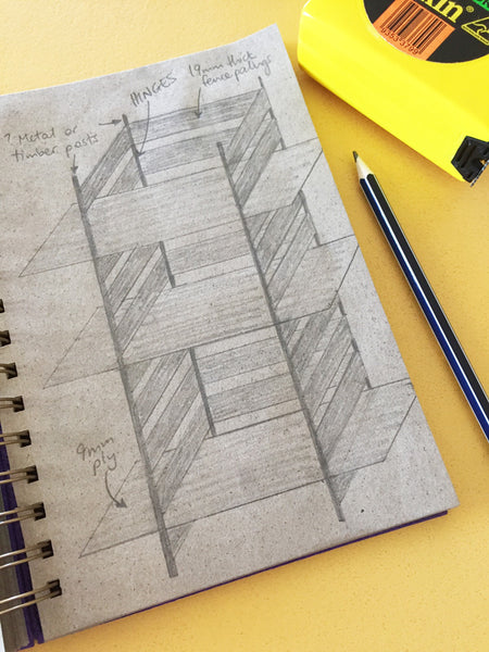 shelf design drawing in a dot grid notebook