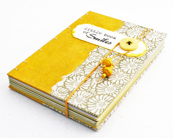 yellow coptic bound journal Little Book of Smiles