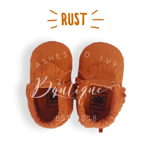 Rust soft sole fringe moccs