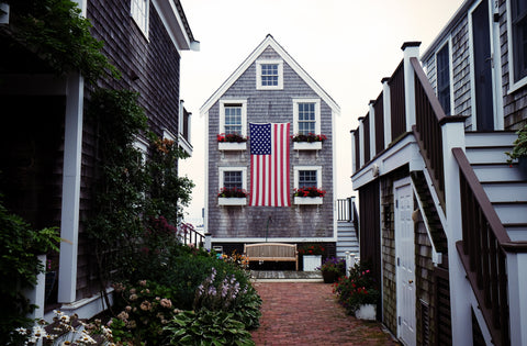 patriotic house with flower boxes