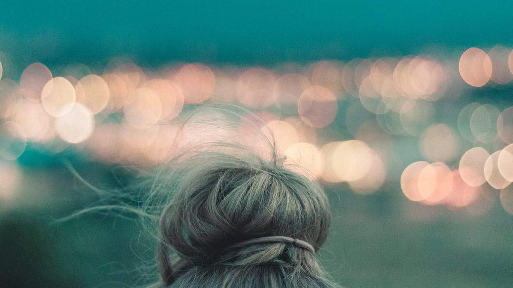 woman blonde hair bun