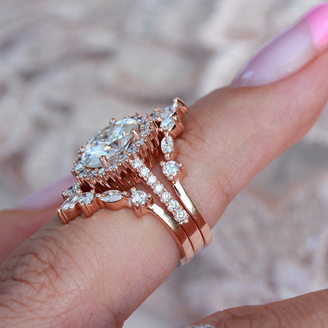 Rose gold three ring set bridal rings, oval moissanite Nia and two Hermes nesting bands