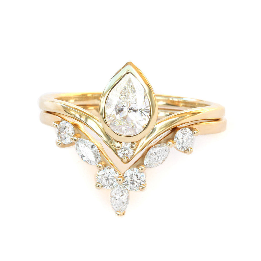Bindi & Hermes Pear diamond engagement rings set