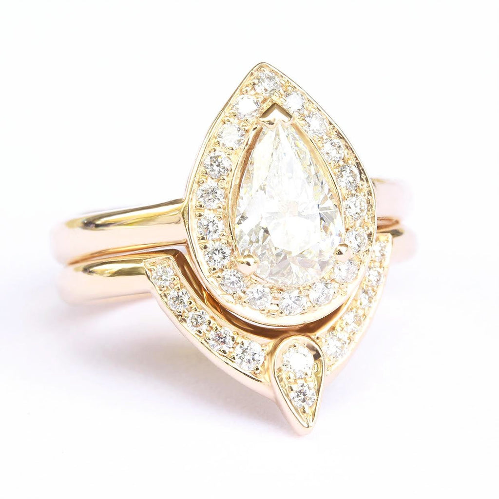 pear moissanite yellow gold engagement ring set
