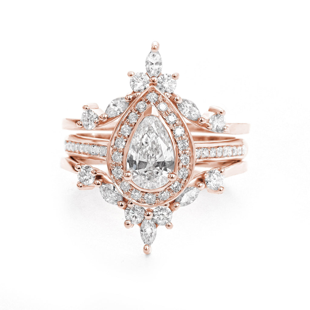pear moissanite diamond halo rose gold trio bridal ring set