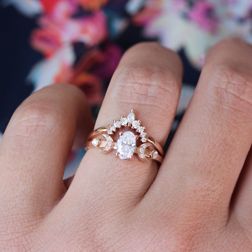 Oval diamond celestial two moons engagement ring