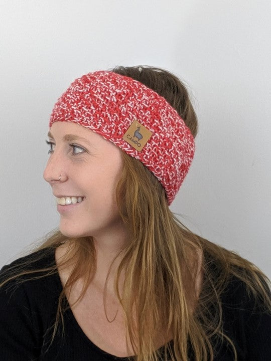 Girl wearing red and white alpaca headband