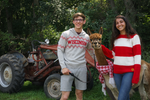 Man and Woman with Alpaca in Alpaca Sweaters