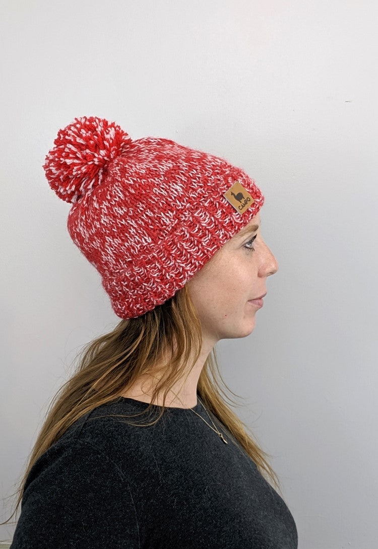 Red and white alpaca pom pom beanie