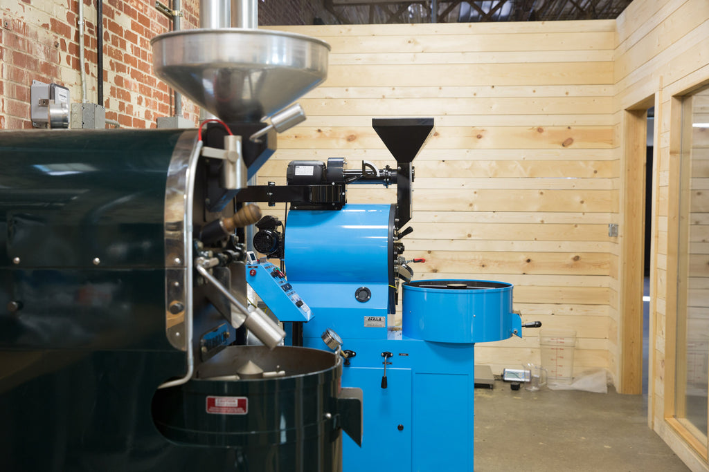 Coffee Roasters Against Brick and Wood Background