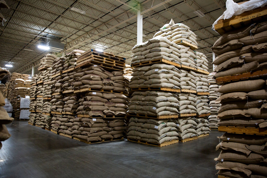 Pallets of Coffee in Jute Bags Stacked in a Warehouse