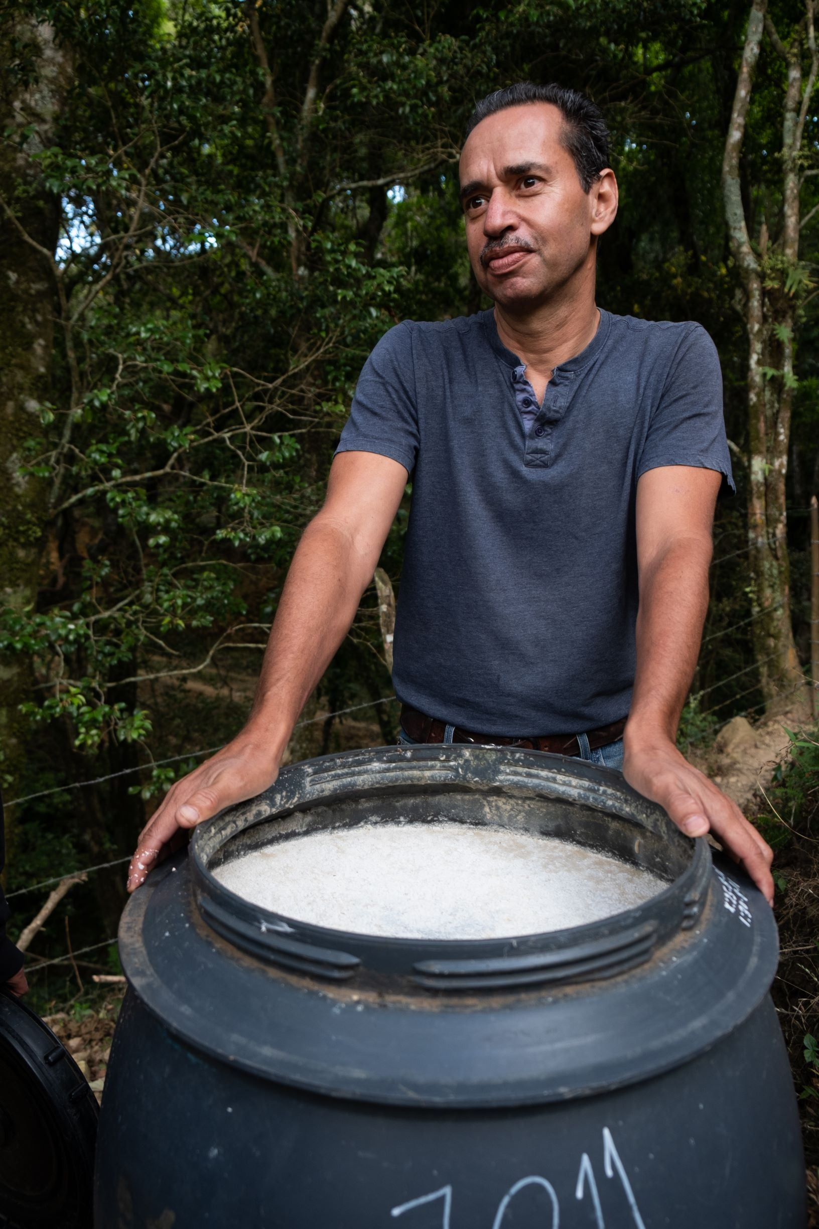 Coffee producer Jorge Vasquéz Ureña with tank of microorganisms