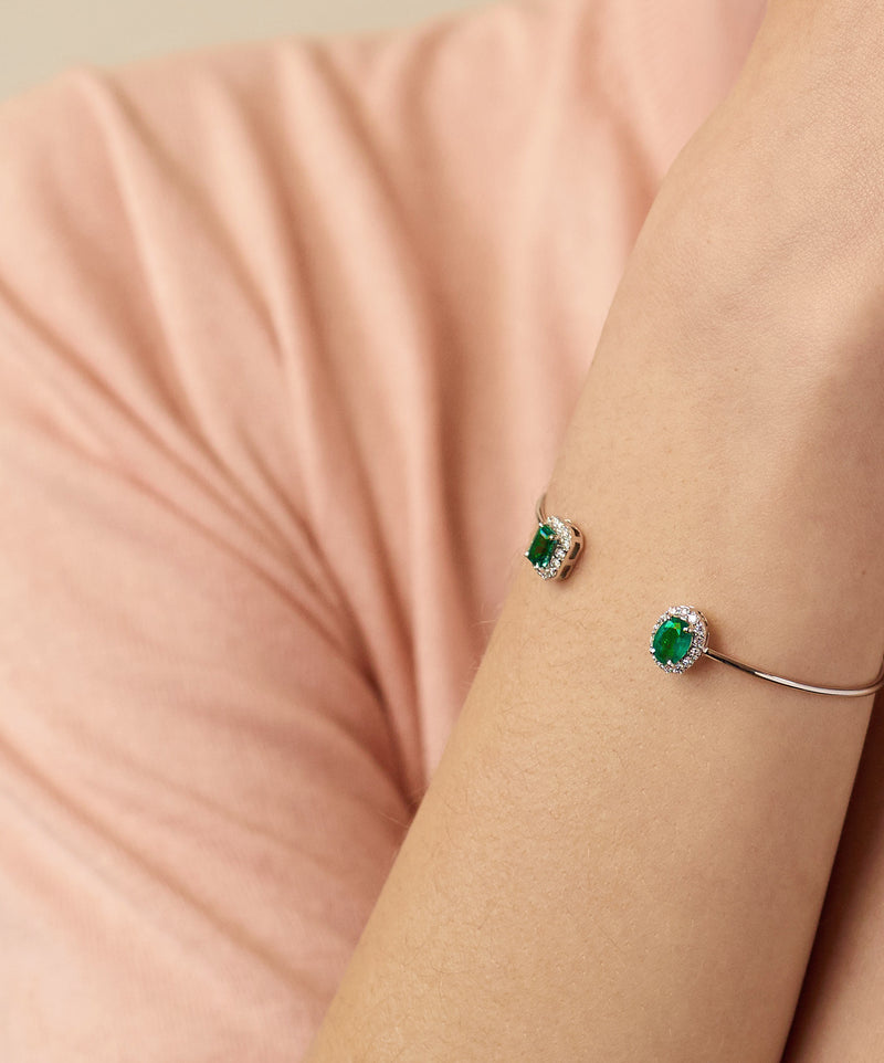 Model wearing Blue Ivy bracelet set with Zambian emeralds and diamonds