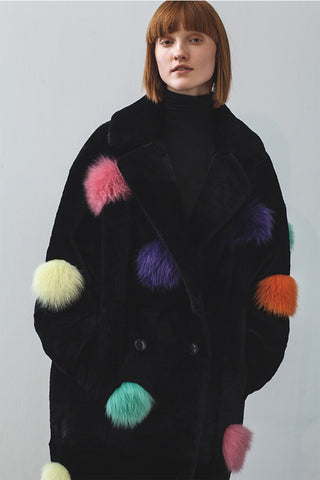 Anne Vest shearling coat in black with colourful pom poms