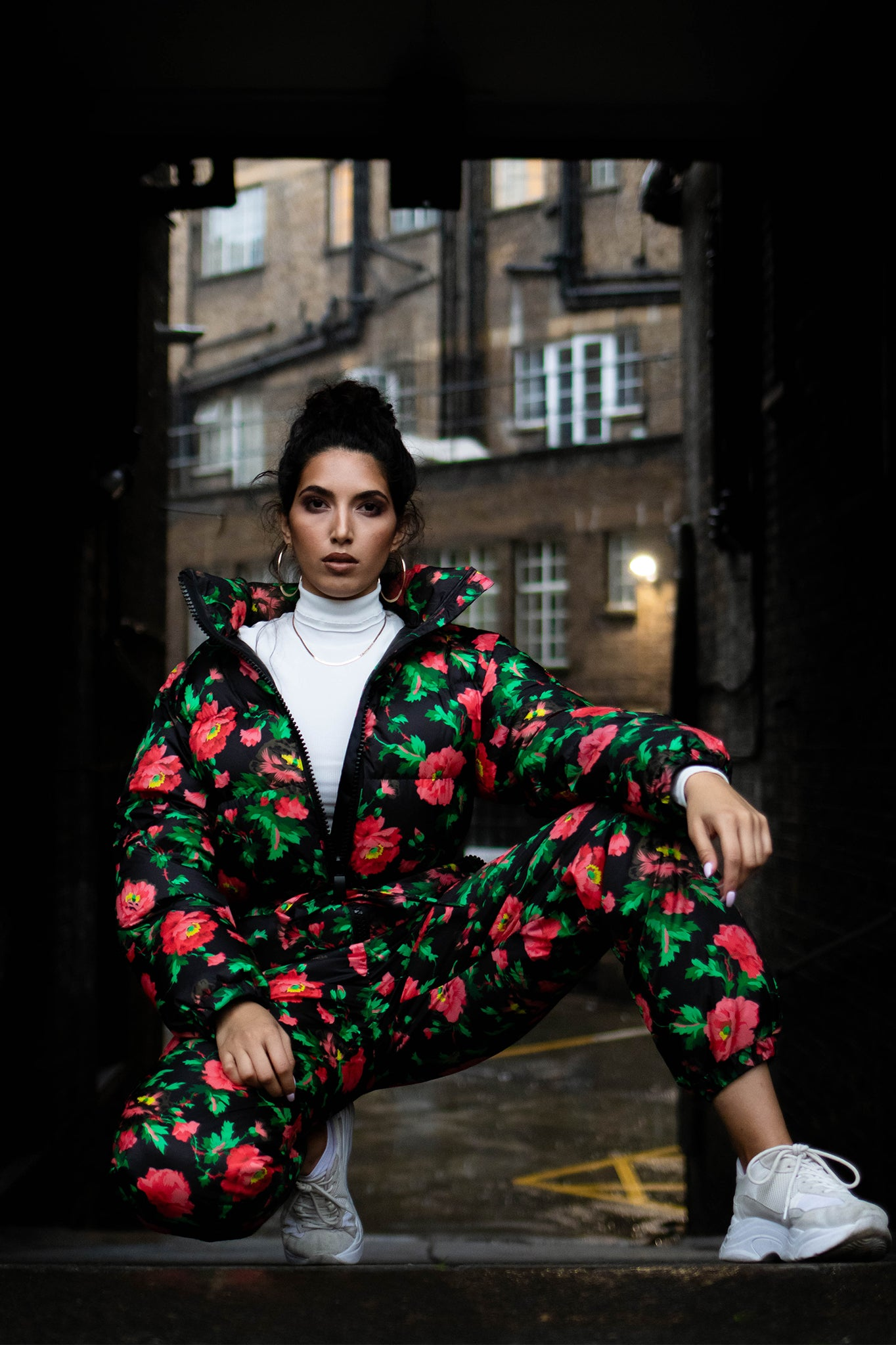 Street Style Fashion of Female model wearing Floral Snow Jump suit