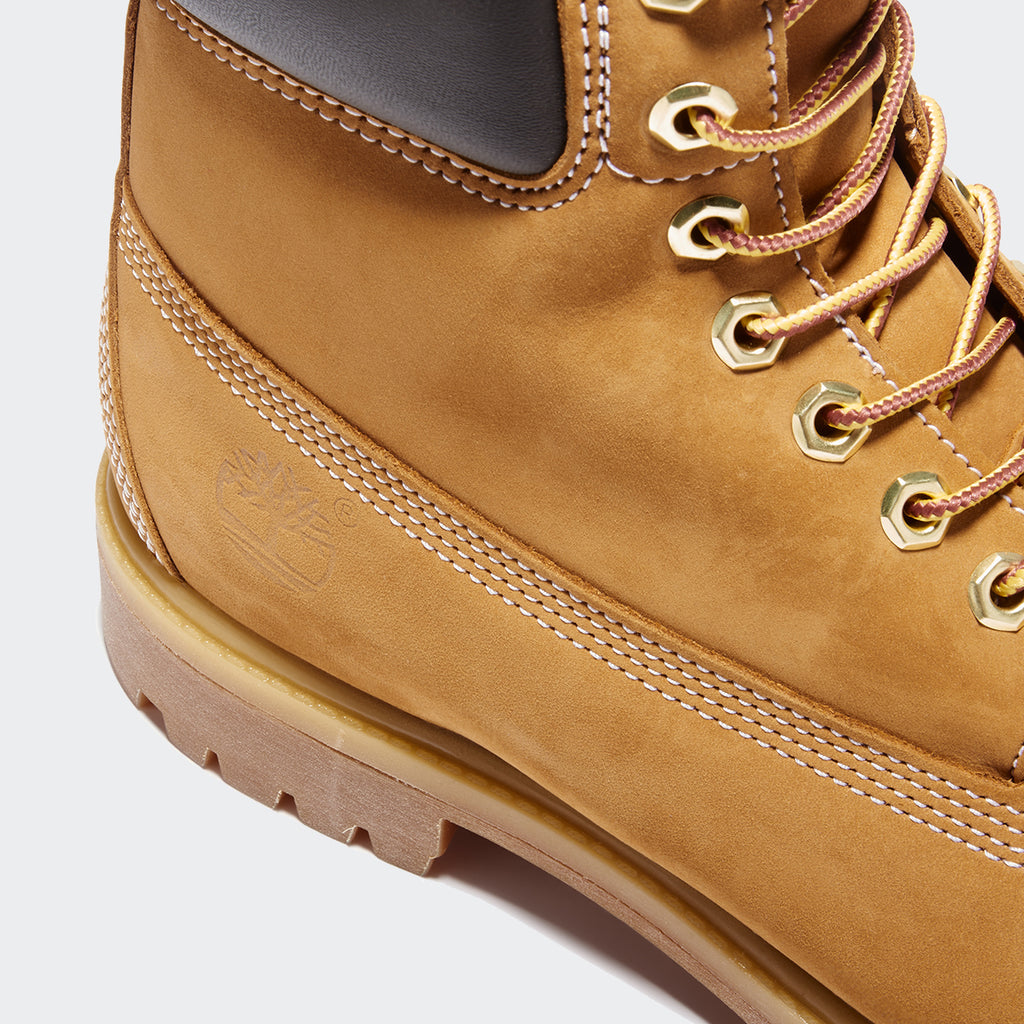 Men's Timberland Icon 6-Inch Premium Waterproof Boots Wheat Nubuck (TB010061713) | Chicago City Sports | close-up view of Timberland logo