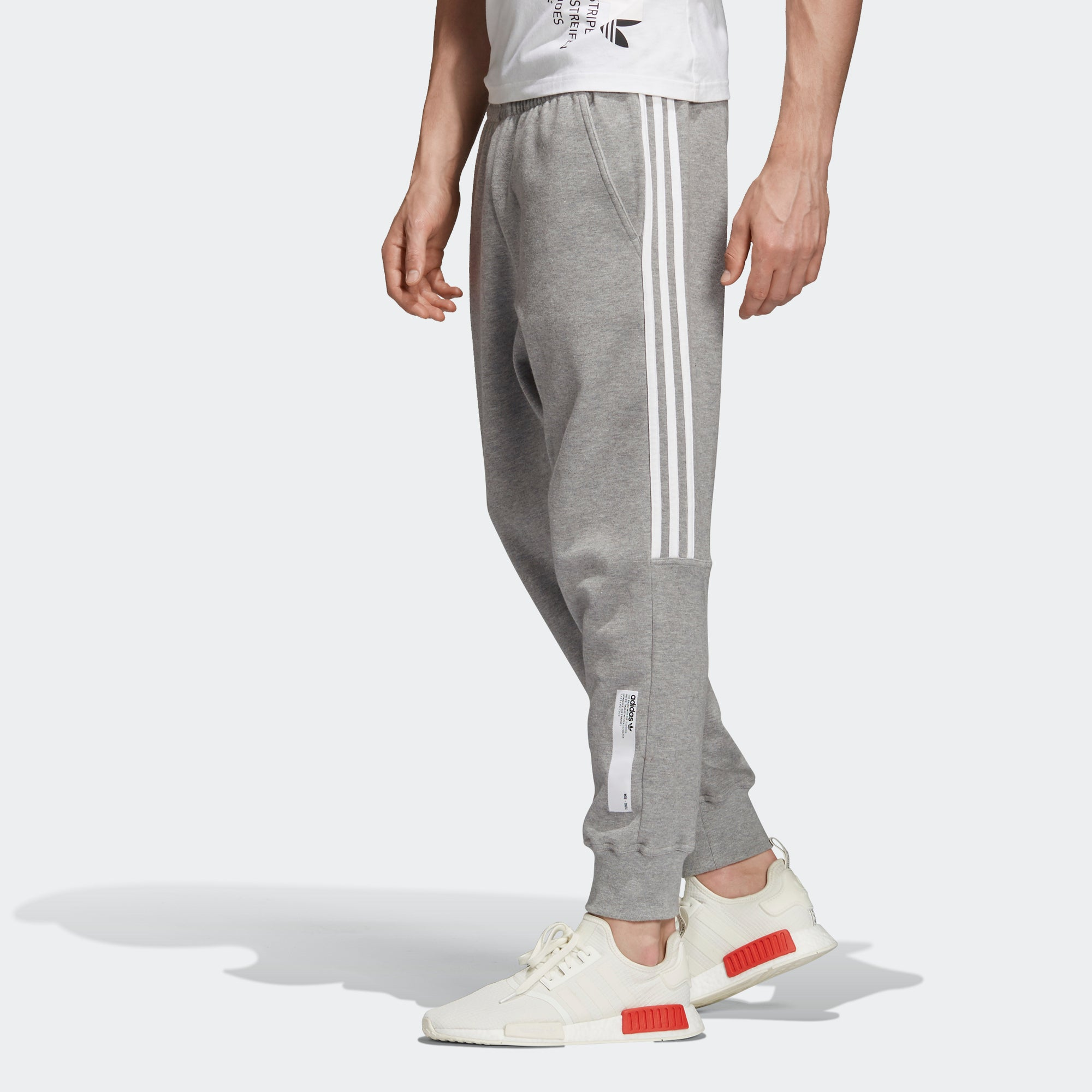 9be3060a3 Men s adidas Originals NMD Sweat Track Pants Core Heather. 1