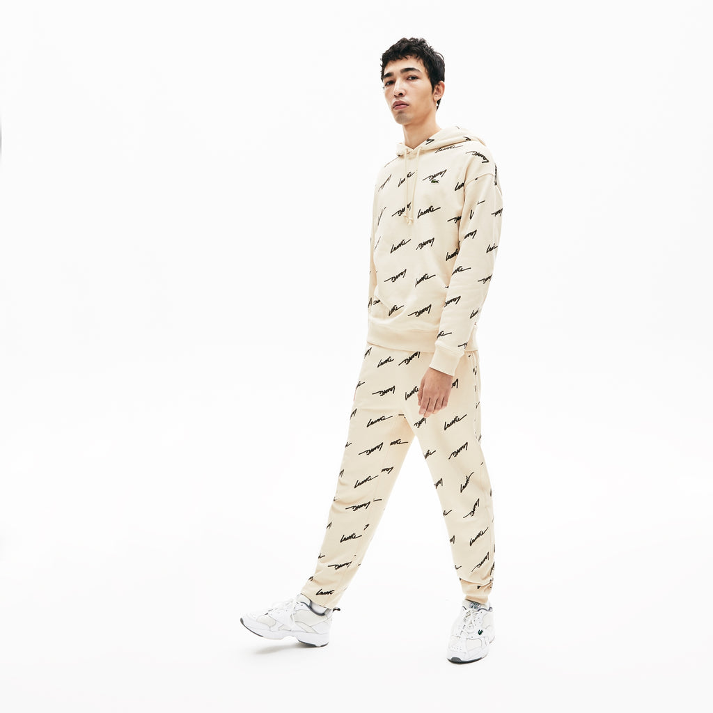 Men's Lacoste Live Hooded Printed Fleece Sweatshirt Beige (SH4383WGU) | Chicago City Sports | front view on model