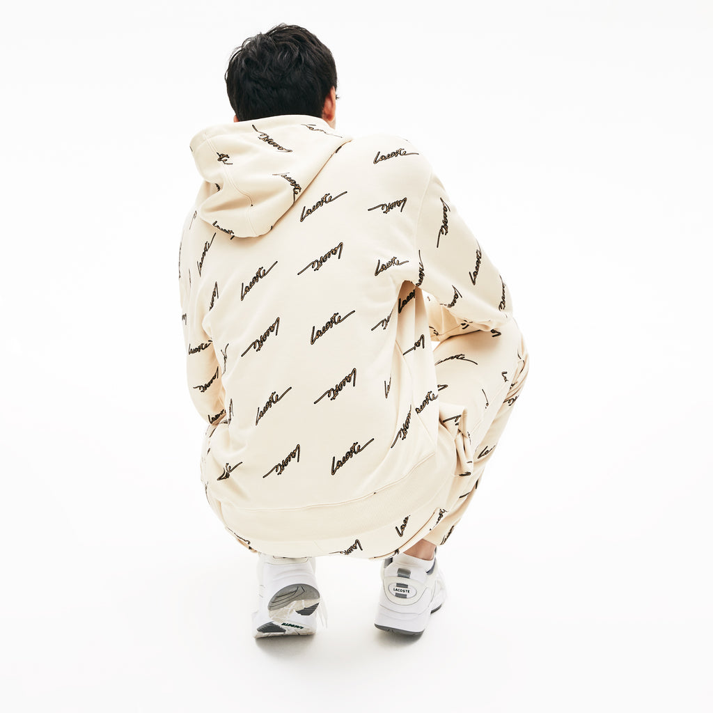 Men's Lacoste Live Hooded Printed Fleece Sweatshirt Beige (SH4383WGU) | Chicago City Sports | rear view on model