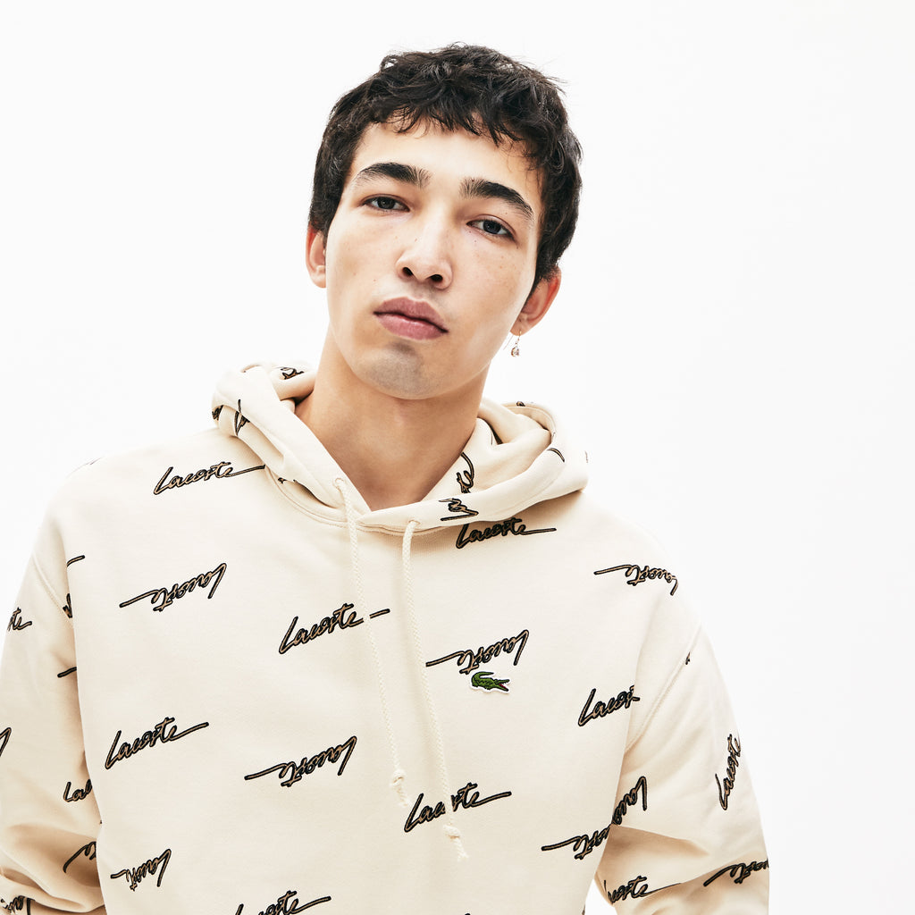 Men's Lacoste Live Hooded Printed Fleece Sweatshirt Beige (SH4383WGU) | Chicago City Sports | close up view on model
