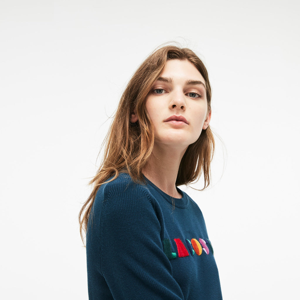 Women's Lacoste Crew Neck Multicolor Embroidery Interlock Sweater Navy Blue AF8762SUA | Chicago City Sports | side view on model