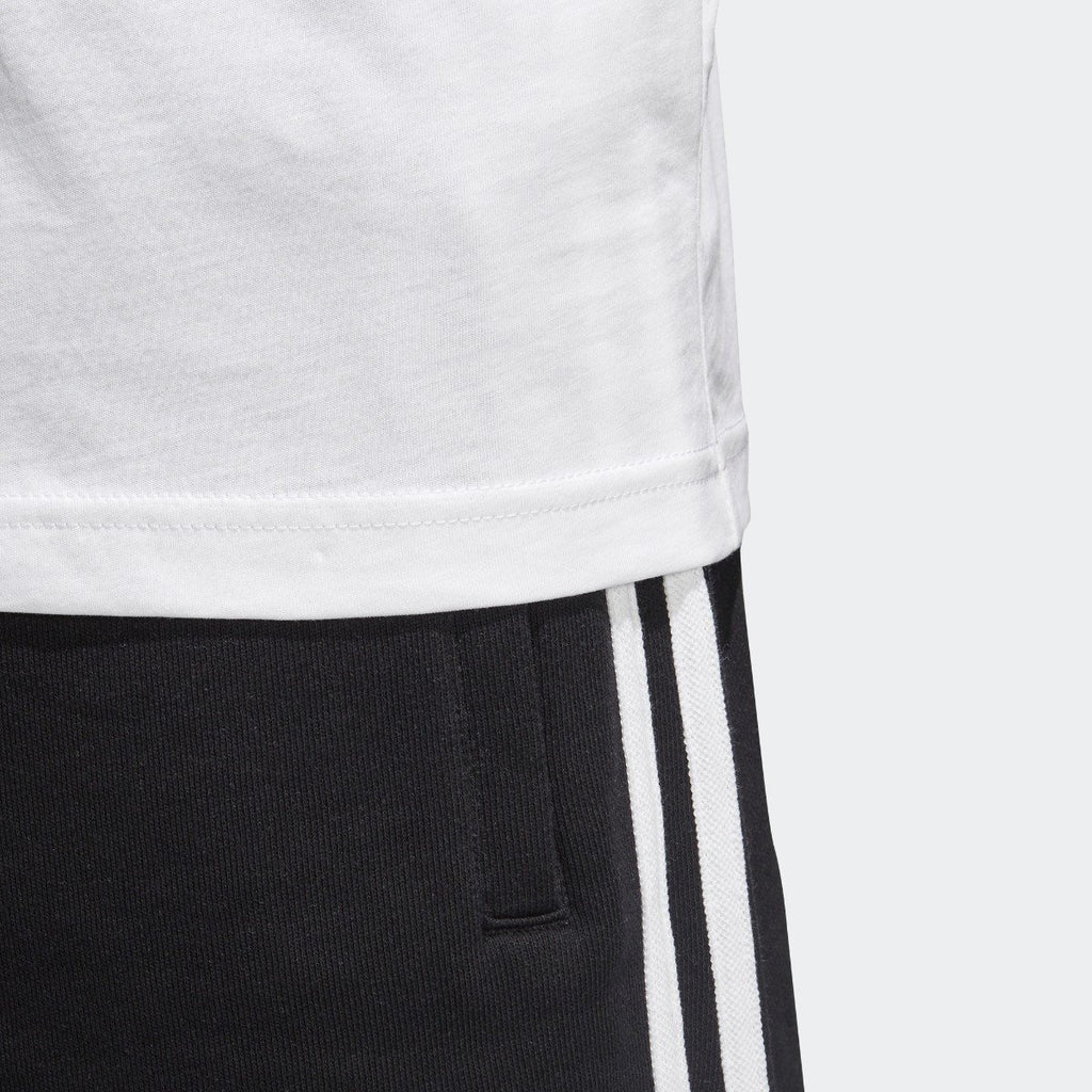 Men's adidas Originals Traction in Action Photo Tee White CE2249 | Chicago City Sports | hem view