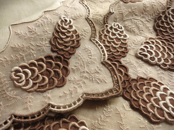"""Pine Cone"" placemat and napkin - breathtaking handwork, practically sculpted onto the fabric. ~Photo by L.M. Smith."