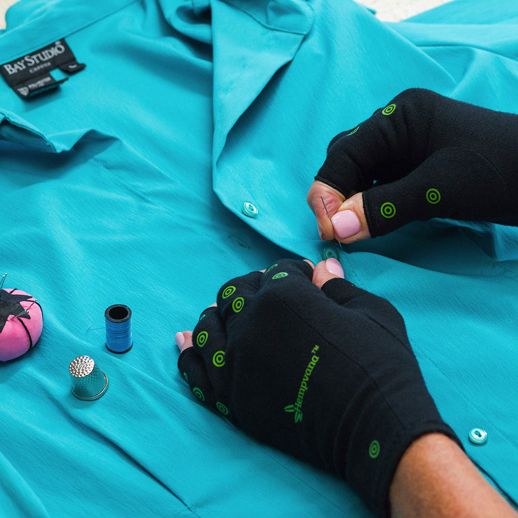 Hempvana Arthritis Gloves in use sewing a button