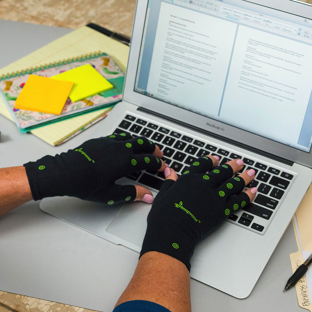 Hempvana Arthritis Gloves in use typing on a laptop