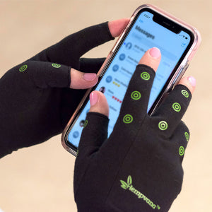 Hempvana Arthritis Gloves in use - cellphone