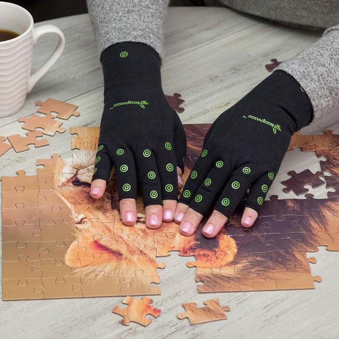 Hempvana Arthritis Gloves in use - puzzle