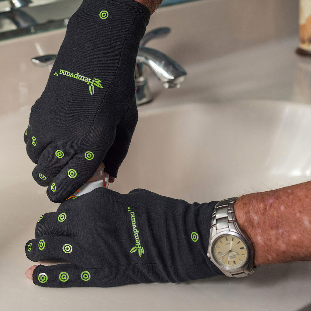 Hempvana Arthritis Gloves in use opening a medicine bottle