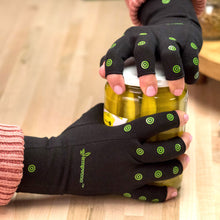 Load image into Gallery viewer, Hempvana Arthritis Gloves in use opening a jar