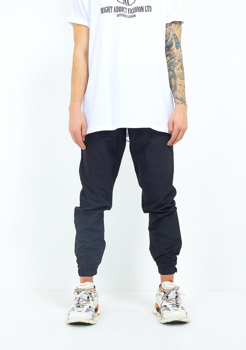 TAPERED NYLON PANTS - BLACK