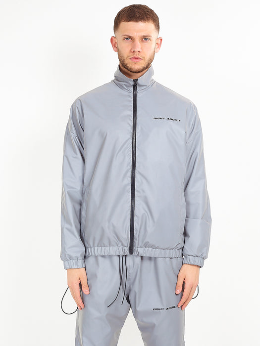 NIGHT ADDICT REFLECTIVE TRACK JACKET