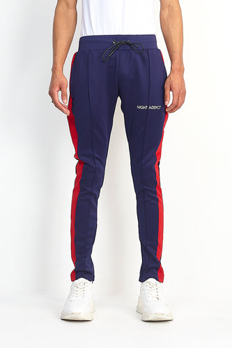 NIGHT ADDICT TECHNICAL TRACK PANTS - BLUE AND RED