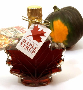 Dark robust maple syrup leaf shaped bottle
