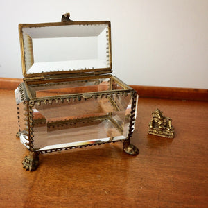 Vitrine display box with beveled glass, paw and claw detail