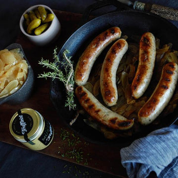 Seared Truffle Brats With Caramelized Onions & Truffle Mustard
