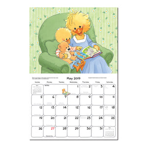 A mom and baby duck read a story in this 2019 suzys zoo calendar page.