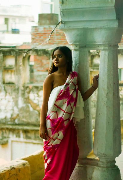 Model wearing shibori pink saree